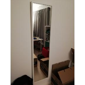 White mirror 'NISSEDAL' from Ikea. Measurements: 40x150cm