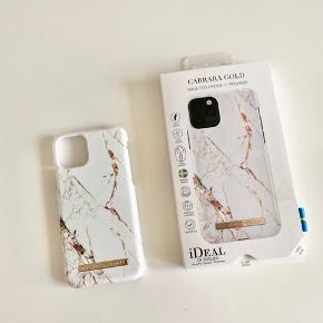 Hvidt marmor cover til iPhone 11 pro  Kasse medfølger. Sælger kun fordi jeg har to :)
