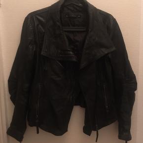 Slidt på den fede måde.. blød og lækker  100% læder udenpå Polyester indeni