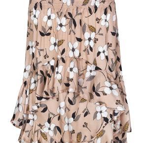Kort nederdel i silke og viskose med blomsterprint og elastik i livet. Viskose / silk
