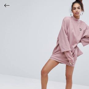 Fra deres beskrivelse:  Puma exclusive to ASOS oversized double layer sweatshirt