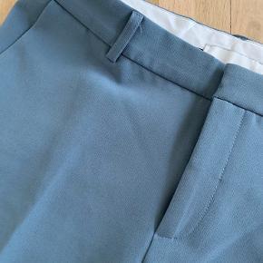 Cassie pants i petroliumsblå.  Brugt få gange.   Bytter ikke😊