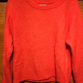 Rød/orange strik BYD