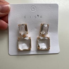 Ny sølv øreringene med hvide krystaler. Aldrig brugt