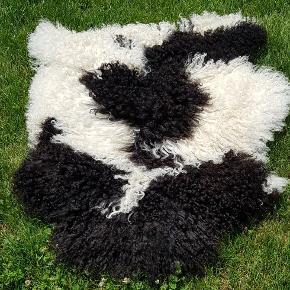 Véritable peau de mouton poils long Neuve acheté à la boutique à zermat
