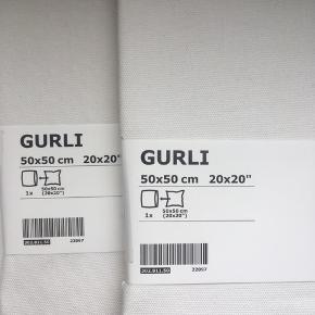 To råhvide pudebetræk fra IKEA. 100 % bomuld. Aldrig åbnet/brugt. Har også en pude i størrelsen til salg fra IKEA.