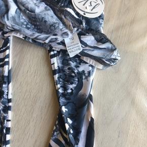 Helt nye super seje leggings fra bæltekompagniet sælges da det ikke lige er mig
