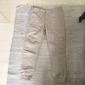 Louis Vuitton LV bukser i bomuld.   God stand.   Kvittering haves ikke.