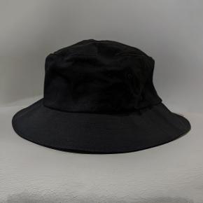 Sort bucket hat/bøllehat fra Flexfit  Aldrig brugt