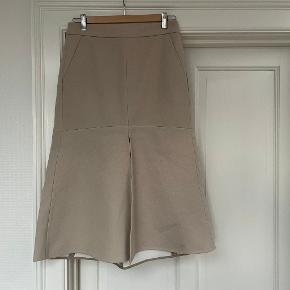 Tibi nederdel