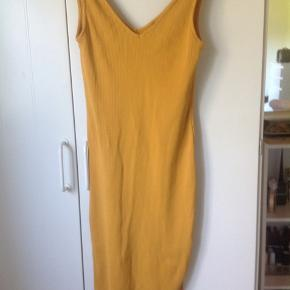Topshop dress in the size 38 petite. The tie straps add a nice touch to the shoulders. It's stretches and fits comfortably.  I lost weight so it no longer fits.
