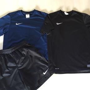 1kortærmet, 1 langærmet og 1 par shorts, Nike str L, 12-13 år, 147-158cm, lille hul bag på ærmet af den sorte tshirt, ellers i fin stand