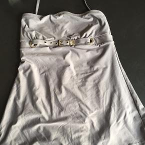 Lækker feminin badedragt fra Michael Kors, aldrig brugt. Nypris 2500,- sælges for 500,- plus porto.