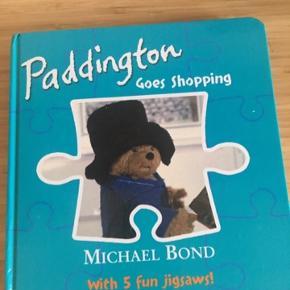Paddington goes shopping Puslespil bog -fast pris -køb 4 annoncer og den billigste er gratis - kan afhentes på Mimersgade 111 - sender gerne hvis du betaler Porto - mødes ikke andre steder - bytter ikke