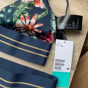 Bikini fra h&m  Overdel i 38 og underdel i 40 Underdelen er højtaljet.