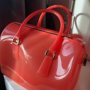 Furla candy tote. It is perfect to take it to beach or when traveling. Not very often used so still in a very good condition