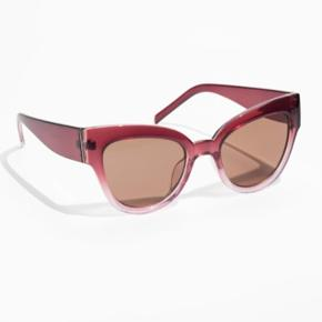 Thick frame cat eye sunglasses a gradient lens.   100% UV protection   Lens category 2