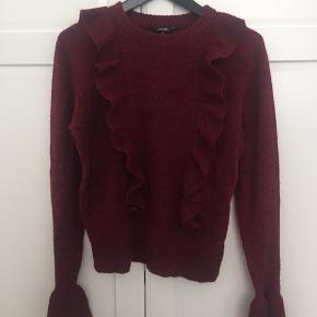 Lumina sweater i farven brick red melange fra MbyM. Kun brugt få gange, meget velholdt.  Kan sende med DAO, køber betaler fragt. Sletter annoncen når varen er solgt.