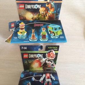 Lego Dimentions figurer. Øverste åbnet med alt er der.  Nederste uåbnet. Byd