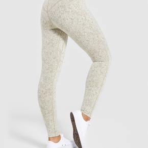 Gymshark leggings in washed khaki marl Inside label removed - only used 2x - slightly too small for me  New price 500.-