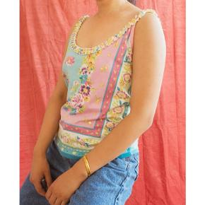 Pretty pastel color top with a cute collar. The back is also super cute! Check out the detail photo.  It has small pearls and decorations. The fabric is stretchy.  Chest measures about 86cm without stretching it.