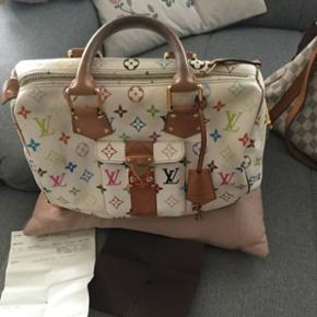 Original lv come with the receipt can negotiate.good condition just the handle little use for using.original price was Nue price ( 3,200 US dollar )