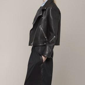 Acne rita leather jacket. Thick leather that has been worn in, now buttery soft. Few scratches and small holes in lining (interior), not seen when worn.   New price: 7600 DKK