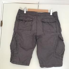 Nye shorts, kun vasket igennem for evt. overskuds farve.  Livvidde 92 cm  str 34  mærke: Unionbay Bytter ikke