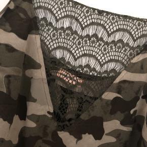 Silke top fra custommade. Brugt 1 gang.
