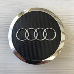 Helt nye Audi centerkapsler i sort carbon look 69mm. låseringen er ca 58-59 mm. 4 stk 185kr. 1 sæt på 4 stk tilbage.