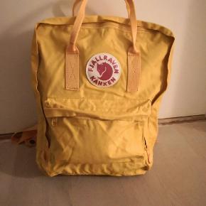 Fjällräven Kånken taske i gul.