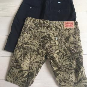 Shorts fra Levis i W36 til kr. 50,00 pr. stk. De sorte er brugt 1 fang. De mønstrede er vasket, men aldrig brugt.
