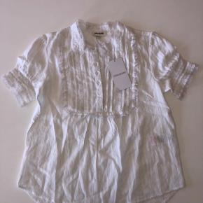 Helt ny og lækker bluse fra Zadig & Voltaire i størrelse 12 år. Nypris er 530,-