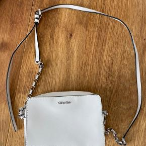 New handbag from Calvin Klein in bright white color. Approx size 10 x 14 cm