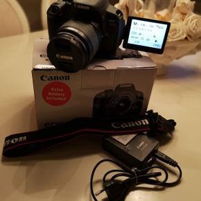 Canon 700D spejlrefleks kamera (med flipskærm / vendeskærm)Næsten ikke brugt - Så god som ny!  Medfølger: •Kamera •Linse •Oplader •Stik med usb •2 stk batterier •Memorycard på 65gb •Rem •Boks  Byd gerne!! Afhentes i Køge