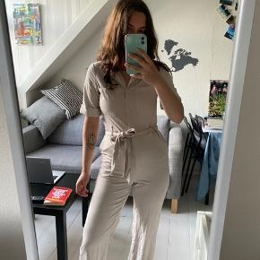 I love this jumpsuit but the last time I washed it it shrunk so it's not comfortable for me any more. Really nice for the summer.