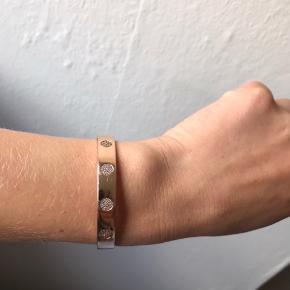 Rosa forgyldt sølv armbånd fra Spirit Icons. Str. S. Passer arm str. 16-18 cm i omkreds.  Brugt og derfor med flere brugsspor.
