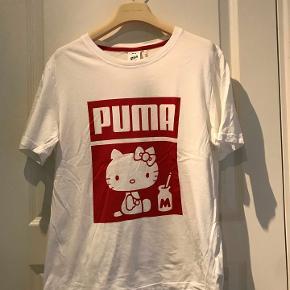 Puma Hello Kitti T-shirt. us str. small. Rummelig model.  Aldrig brugt.  kan ses i Rungsted