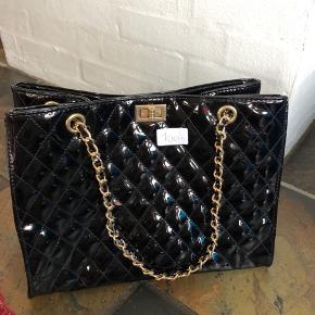 Ligner en Chanel taske - mp 100