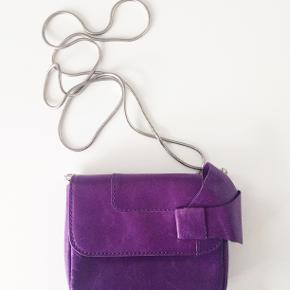 New CORSOCOMO lather bag with arm band in a box. 20x14.5x5 cm.