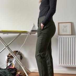 Flotte bukser fra COS 96% uld- har aldrig været brugt.