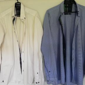 Mærke med materiale er væk i den hvide skjorte.  Sender med DAO SE OGSÅ MINE 700 ANDRE ANNONCER 😍🍀