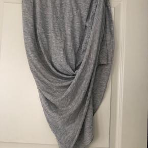 Cool elsstisk Jersey nederdel. Passer også en str M