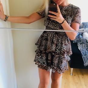 Leopardprint kjoleKun brugt få gange. Står som ny