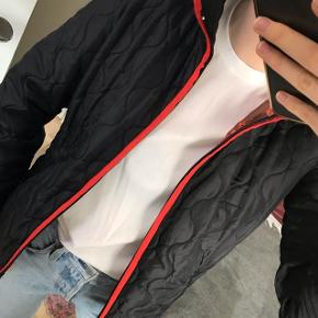 Light quilted jacket from Bensimon Black with red trimming  Size S, very good condition