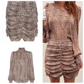 Helt nyt sæt med bluse str xl nederdel str l   Desværre købt i forkert str ( er lige købt )   Ny pris ca 1100