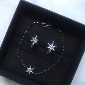 Smukke stjerne øreringe og armbånd. Stenene skinner i virkeligheden, svært at se på billedet.
