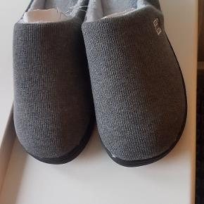 New home shoes. Vere comfortable, very soft inside, with memory foam in the sole.