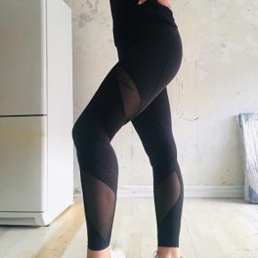 Sorte tights med mesh detaljer