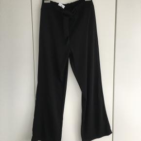Smarte/flotte selskabs bukser eller andet  Nye med prismærke - Skridt længde 72 Stof 100% polyester